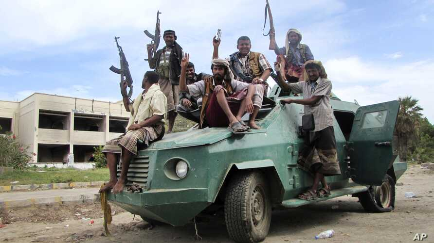 Militiamen loyal to President Abed Rabbo Mansour Hadi ride on an army vehicle on a street in Aden, Yemen, March 20, 2015.