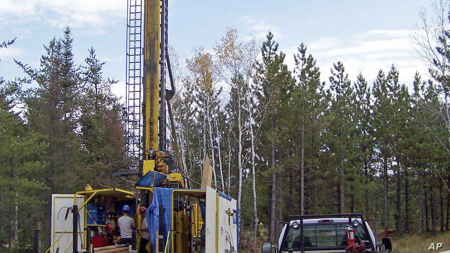 FILE - A prospecting drill rig bores into the bedrock near Ely, Minn., in search of copper, nickel and precious metals that Twin Metals Minnesota LLC, hopes to mine near the Boundary Waters Canoe Area Wilderness in northeastern Minnesota, Oct. 4, 201