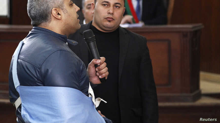 Al Jazeera journalist Mohamed Fahmy speaks before the judge at a court in Cairo, February 12, 2015. The two remaining Al Jazeera journalists, Mohamed Fahmy and Baher Mohamed, were released from an Egyptian jail on Thursday after more than 400 days, b...