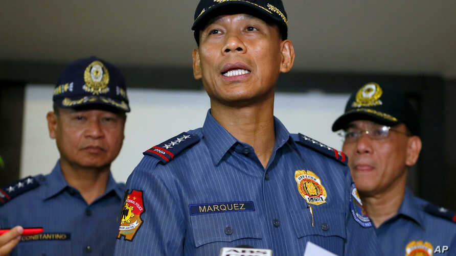 Philippine National Police Director General Ricardo Marquez reads the joint statement of the military and police on the beheading of Canadian hostage John Ridsdel of Calgary, Alberta by Muslim extremist Abu Sayyaf group in southern Philippines on Apr