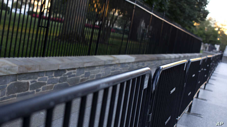 Two layers of fence are seen along the North Lawn of the White House in Washington, D.C.,Sept. 23, 2014.