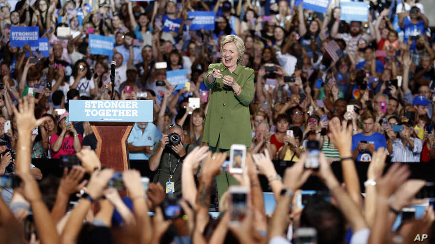 Democratic presidential candidate Hillary Clinton gestures at the audience as he arrives at a campaign event at the Florida State Fairgrounds Entertainment Hall, Friday, July 22, 2016, in Tampa, Florida.