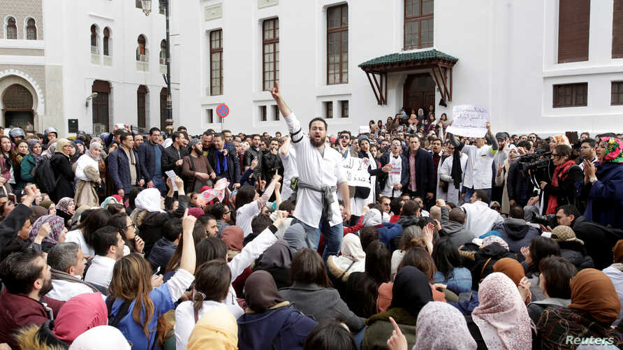 FILE - Algerian doctors, who are completing their residency stage of their studies, hold a sit-in protest in Algiers , Feb. 12, 2018.