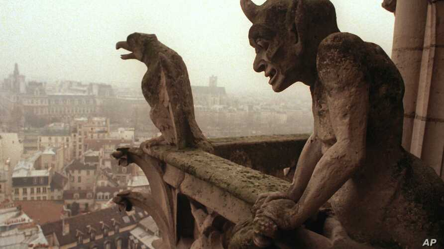 FILE - Gargoyles watch over the streets of Paris from the top of the Notre-Dame cathedral.