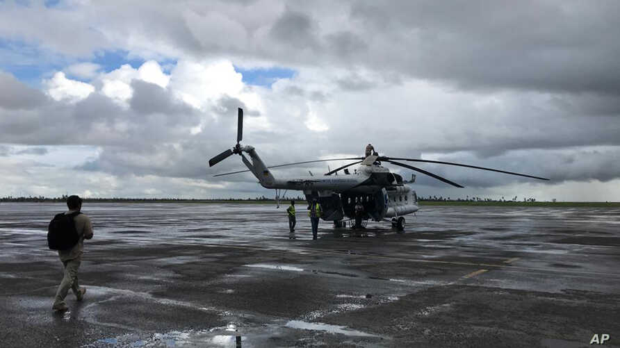 A UN humanitarian helicopter prepares for a day of work, at the airport in the Mozambique city of Beira, March 22 2019.  Some hundreds of people are dead, many more still missing and with many thousands at risk from massive flooding in Mozambique, Ma