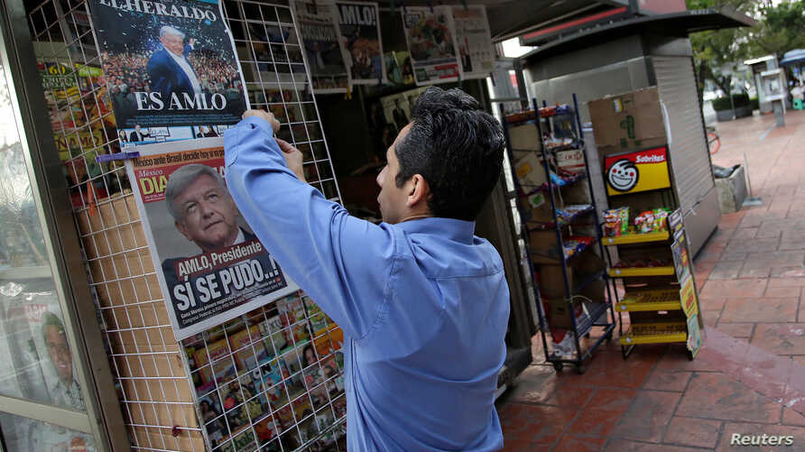 A vendor arranges newspapers at his stall after the election of Andres Manuel Lopez Obrador as new Mexican President in Mexico City, Mexico, July 2, 2018.