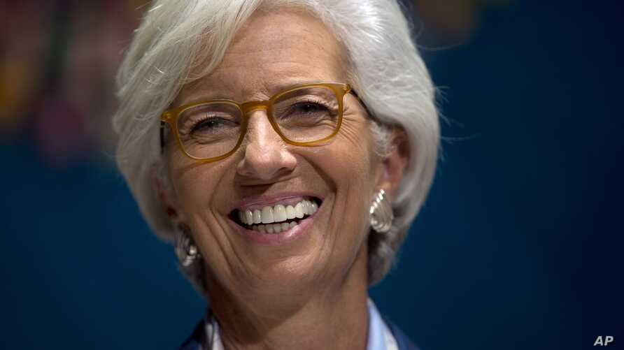 International Monetary Find (IMF) Managing Director Christine Lagarde laughs during a forum in Lima, Peru, Wednesday, Oct. 7, 2015, during the annual meetings of the World Bank Group and IMF.