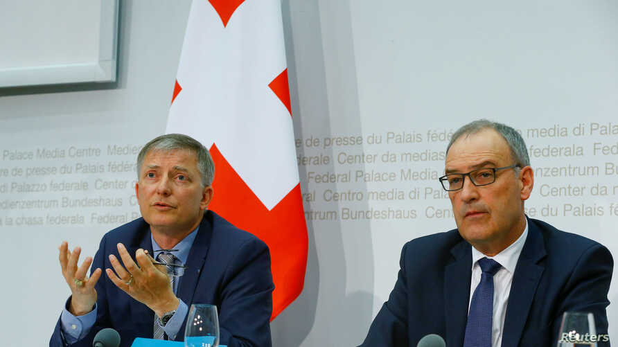 Switzerland's Defense Minister Guy Parmelin (R) and Swiss Federal Intelligence Service (NDB) director Markus Seiler attend a news conference in Bern, Switzerland, May 2, 2017.