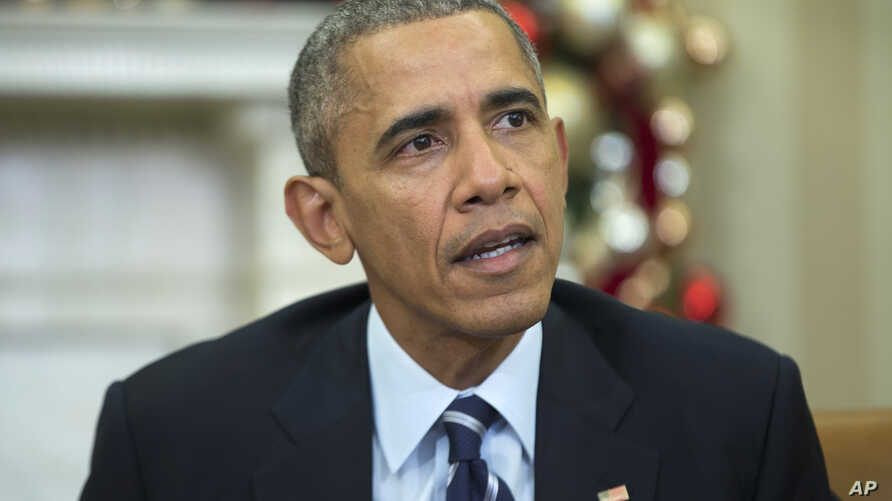 FILE - President Barack Obama makes a statement on Wednesday's mass shooting in San Bernardino, Calif., in the Oval Office of the White House in Washington, Dec. 3, 2015.