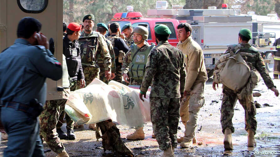 Afghan National Army (ANA) soldiers transport a victim to an ambulance after a suicide attack in Lashkar Gah, Helmand province, Afghanistan, Feb. 11, 2017.