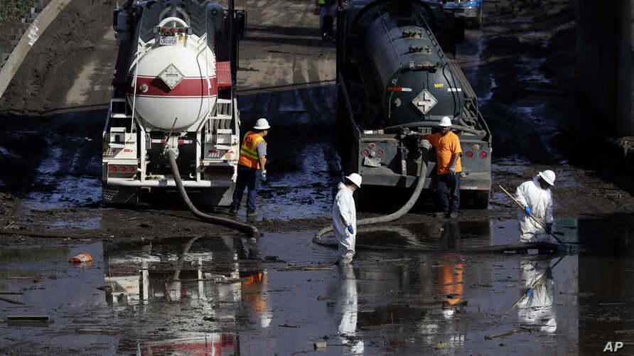 A work crew cleans up an area of Highway 101 that flooded in Montecito, Calif., Jan. 12, 2018.