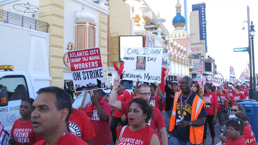 FILE - Union members picket  outside the Trump Taj Mahal caino in Atlantic City, N.J.