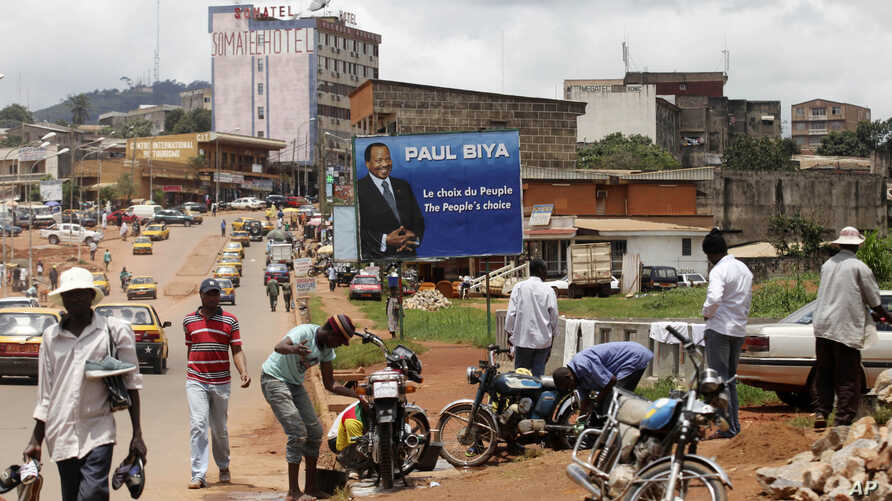Half of the population of the XXX population of the capital of Cameroon has to search for water every day. This photograph was taken in Yaounde before President Paul Biya was re-elected. Biya has been in power since 1982.