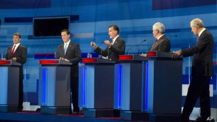 Republican presidential candidates, from left to right: Texas Gov. Rick Perry; former Pennsylvania Sen. Rick Santorum; former Massachusetts Gov. Mitt Romney; former House Speaker Newt Gingrich; and Rep. Ron Paul, R-Texas take part in the South Caroli