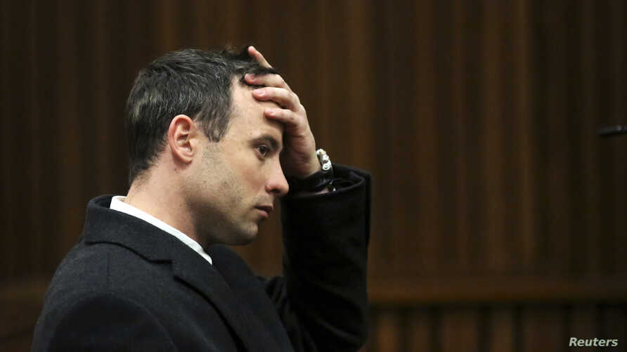 Olympic and Paralympic track star Oscar Pistorius gestures during his trial for the murder of his girlfriend Reeva Steenkamp, at the North Gauteng High Court in Pretoria, July 8, 2014.