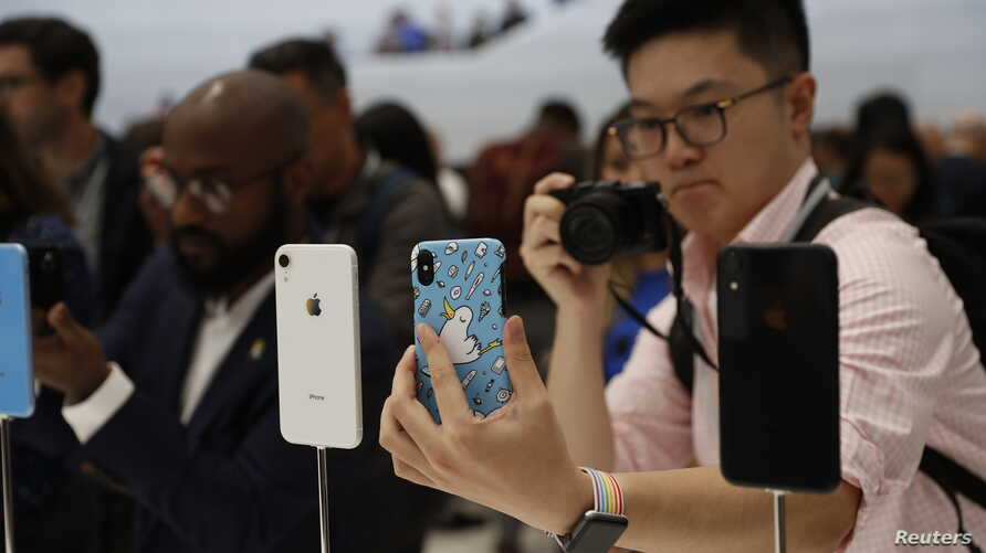 A demonstration of the newly released Apple products is seen following the product launch event at the Steve Jobs Theater in Cupertino, California, U.S. Sept. 12, 2018.