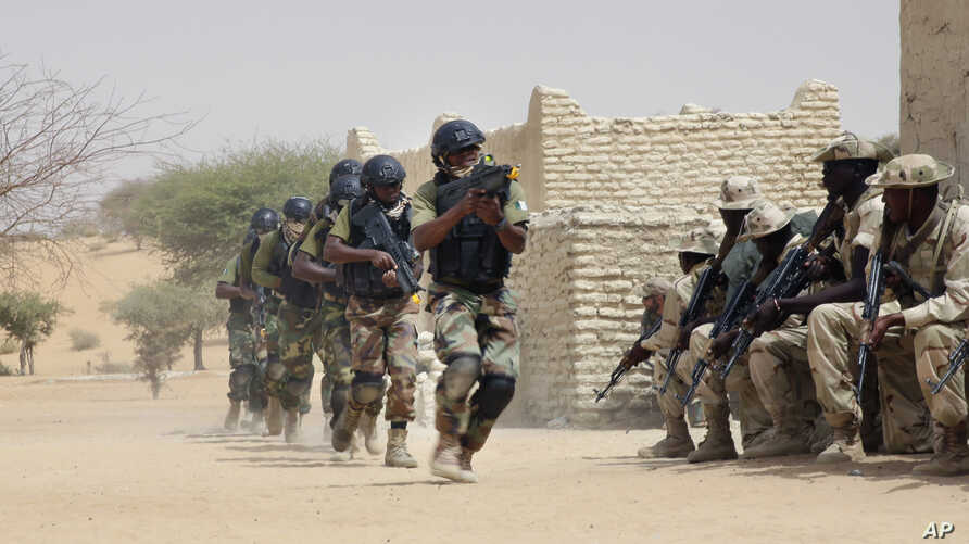 FILE- Nigerian special forces and Chadian troops participate with U.S. advisers in the Flintlock exercise in Mao, Chad, March 7, 2015. This year's just-begun Flintlock exercise, designed to strengthen security partnerships and train elite counterterr...