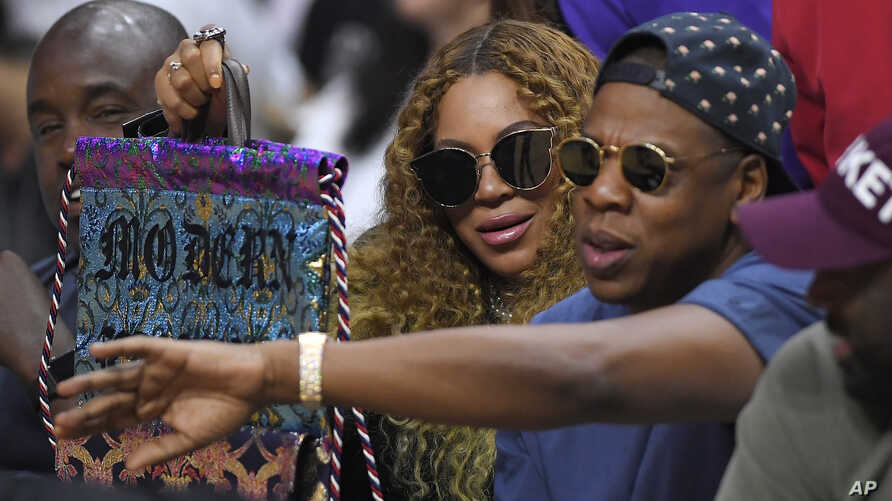 FILE - Beyonce and Jay Z watch during the first half of an NBA basketball first-round playoff series between the Los Angeles Clippers and the Utah Jazz in Los Angeles, -April 30, 2017.