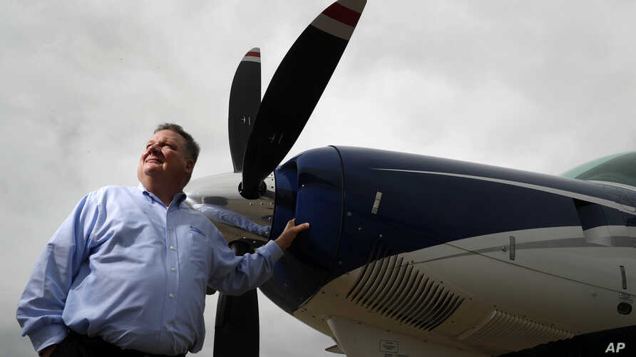 Air Choice One CEO Shane Storz poses for a photo with one of his company's aircraft in St. Louis, March 28, 2017. Air Choice One is an airline based in St. Louis that flies small planes to destinations in the Midwest and participates in the Departmen