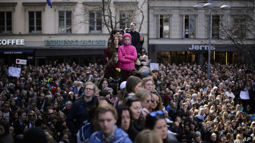 """Thousands of people attends a """"Lovefest"""" vigil against terrorism in central Stockholm, Sweden, Sunday, April 9, 2017. A hijacked truck was driven into a crowd of pedestrians and crashed into the department store on Friday in the Swedish capital."""