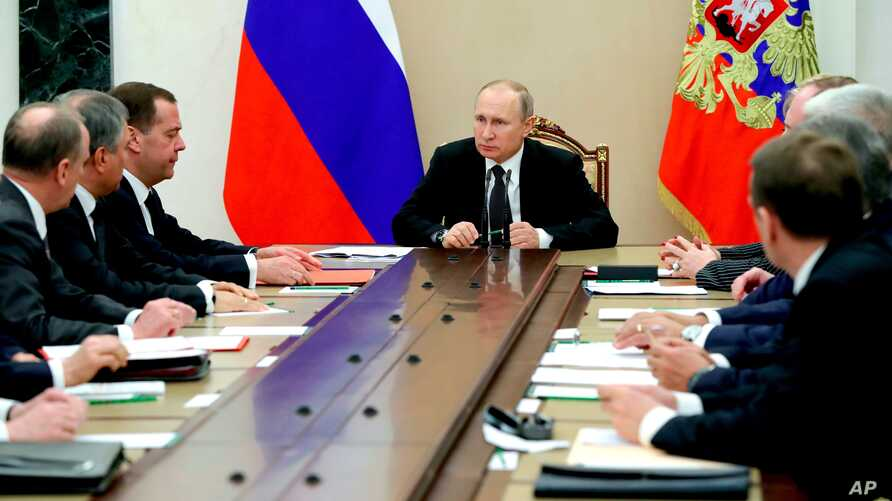 FILE - Russian President Vladimir Putin, center, leads a Security Council meeting in Moscow, Russia, March 30, 2018.