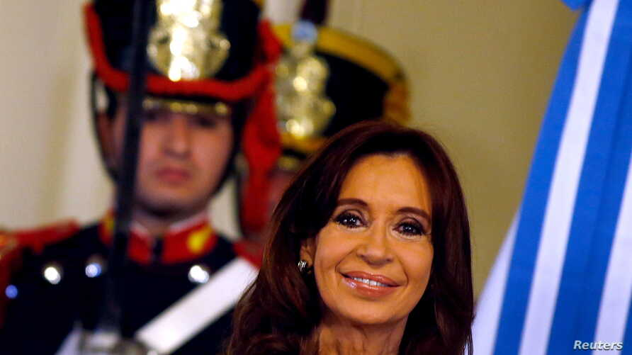 Argentina's President Cristina Fernandez de Kirchner smiles during a ceremony on her last day in office at the Casa Rosada Presidential Palace in Buenos Aires, Argentina, Dec. 9, 2015.