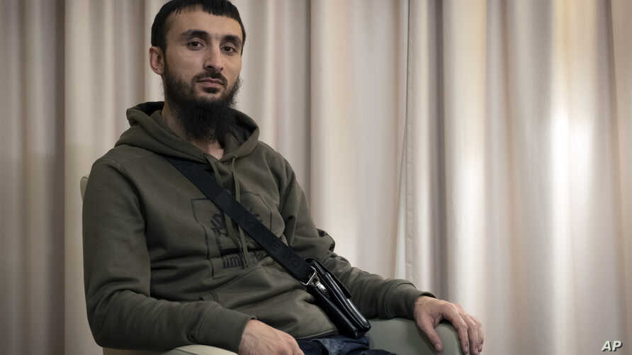 FILE - Tumso Abdurakhmanov, the 32-year-old Chechen video blogger, is photographed during an interview with The Associated Press somewhere in Poland, Nov. 14, 2018.