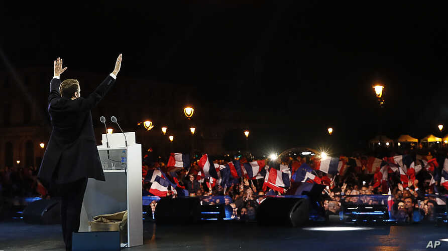 Incoming French President Emmanuel Macron delivers a speech in front of the Pyramid at the Louvre Museum in Paris, May 7, 2017.