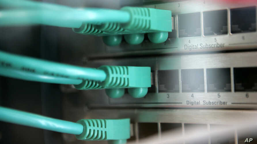 FILE - A photo shows network cables connected to a server at the CeBIT Computer and IT Far in Hanover, northern Germany.