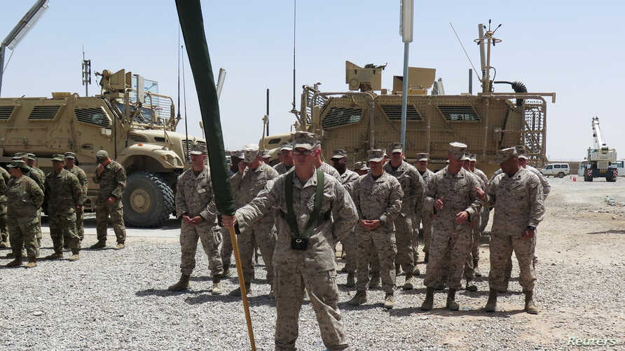 U.S. Marines stand at attention during a transfer of authority ceremony at Shorab camp, in Helmand province, Afghanistan, April 29, 2017.