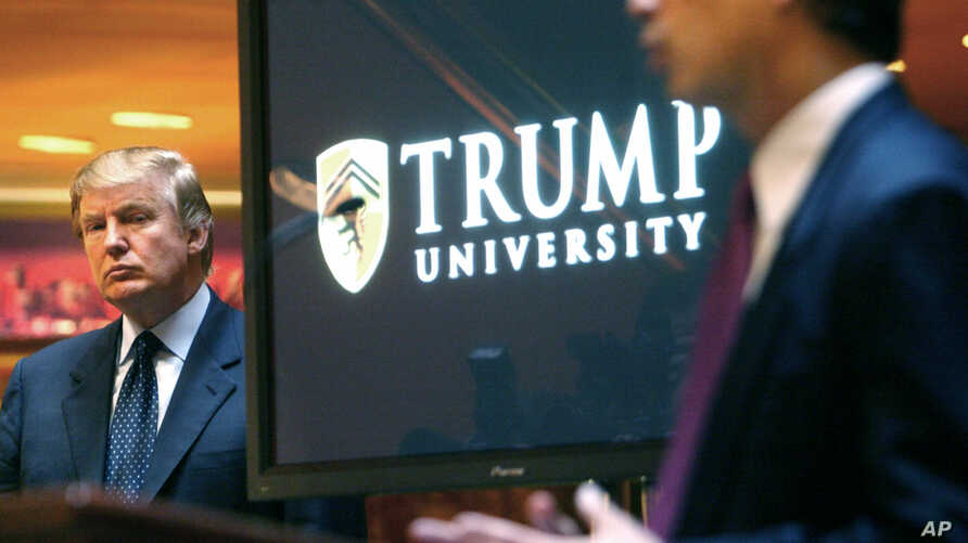 A class-action lawsuit involving President-elect Donald Trump, shown during unveiling of the  now-defunct Trump University, May 23, 2005, is expected to start November 28.