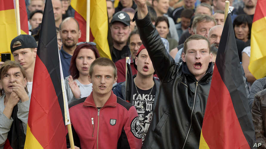 People attend a demonstration in Chemnitz, eastern Germany, Sept.7, 2018, after several nationalist groups called for marches protesting the killing of a German man two weeks ago, allegedly by migrants from Syria and Iraq.
