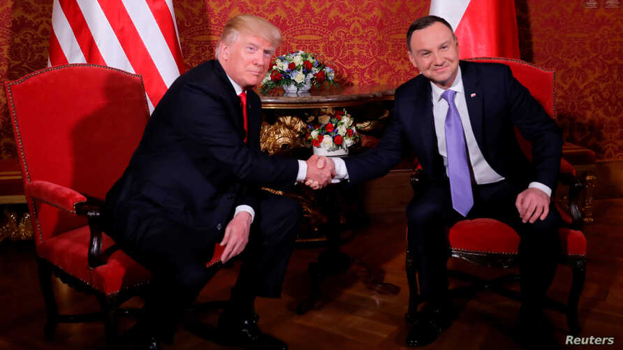 U.S. President Donald Trump is greeted by Polish President Andrzej Duda as he visits Poland during the Three Seas Initiative Summit in Warsaw, July 6, 2017.