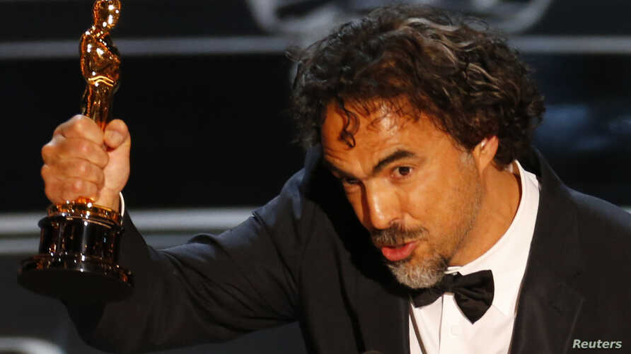 """Director Alejandro Inarritu accepts the Oscar for Best Director for his film """"Birdman"""" at the 87th Academy Awards in Hollywood, California, Feb. 22, 2015."""