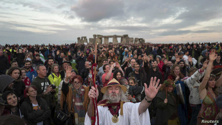 Revellers celebrate the summer solstice at Stonehenge on Salisbury Plain in southern England, June 21, 2016.