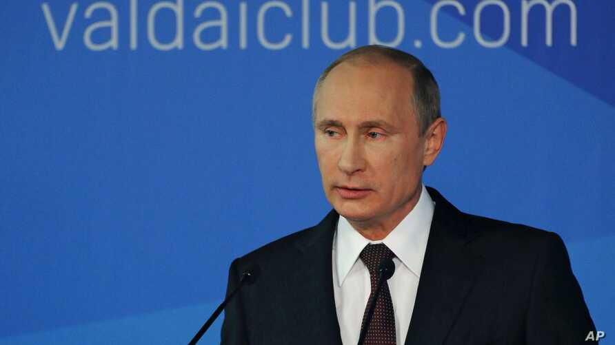 Russian President Vladimir Putin speaks to political experts at a meeting of the Valdai International Discussion Club in Sochi, Russia, Oct. 24, 2014.