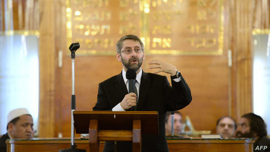 FILE - Great Rabbi of France Haim Korsia speaks during an ecumenical ceremony at the synagogue of Sarcelles, north of Paris, on July 21, 2014.