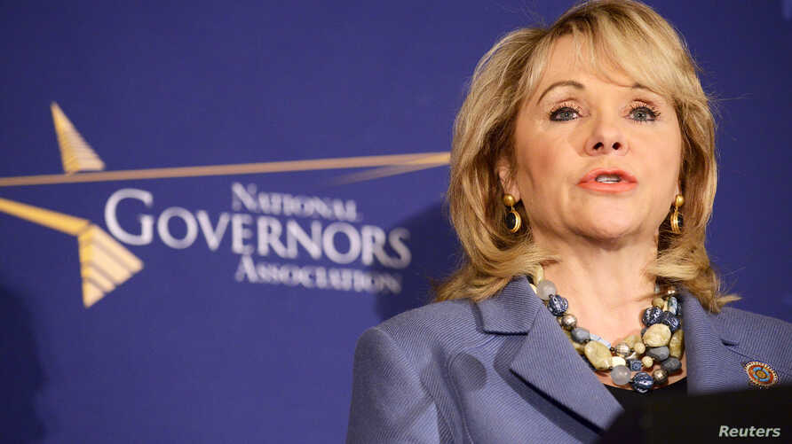 FILE - Oklahoma Republican Governor Mary Fallin makes remarks before the opening of the National Governors Association Winter Meeting in Washington, Feb. 22, 2014. Fallin vetoed abortion legislation in her state on Friday, saying it would not withsta