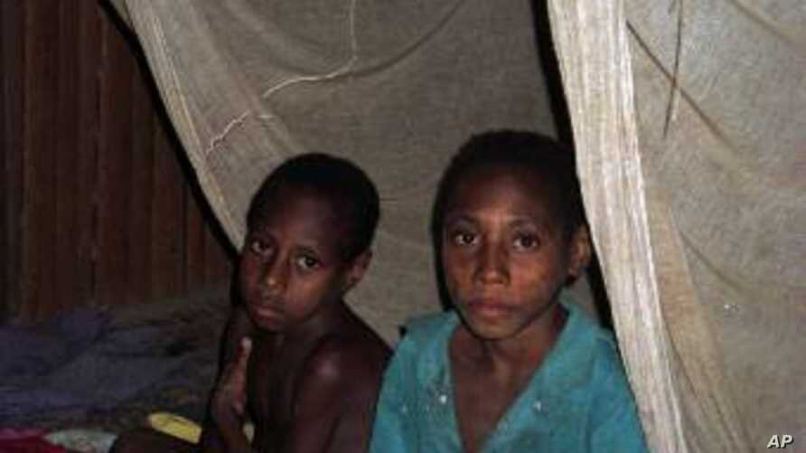 FILE – Mosquito nets helped control malaria after an outbr
