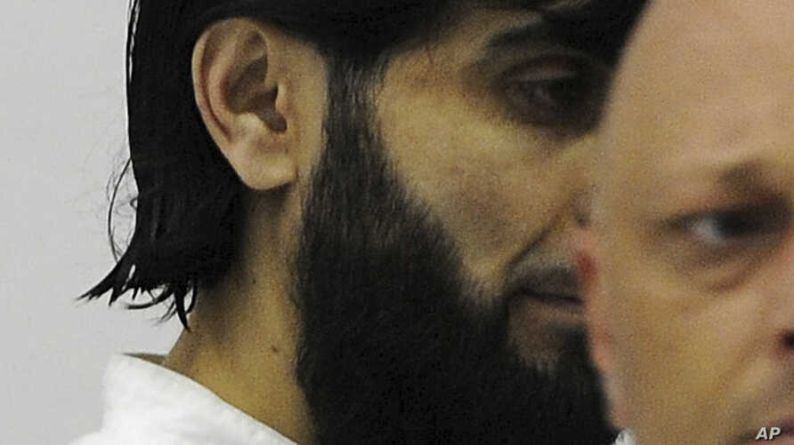 FILE - In his July 15, 2008 file photo, Rafik Mohamad Yousef enters the dock at the Higher Regional Court in Stuttgart, Germany. German prosecutors said the known Islamic extremist was shot and killed by police after he attacked an officer with a kni