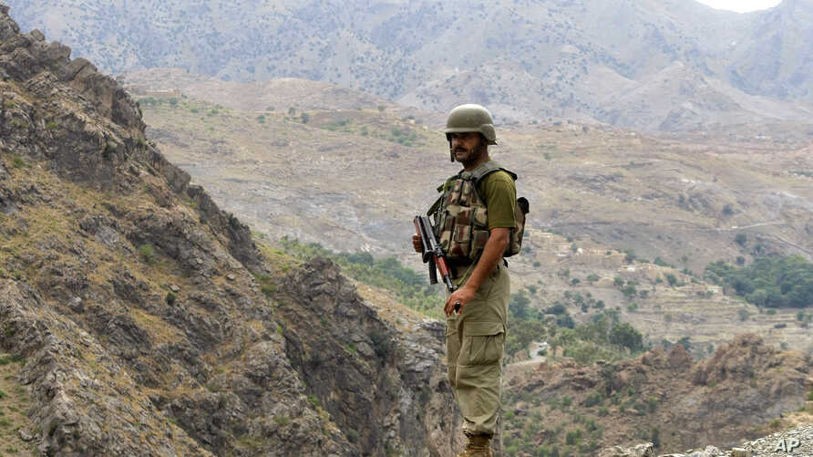 A Pakistan army soldier stands guard in the Pakistani tribal area of Khyber near the Torkham border post between Pakistan and Afghanistan, June 15, 2016.