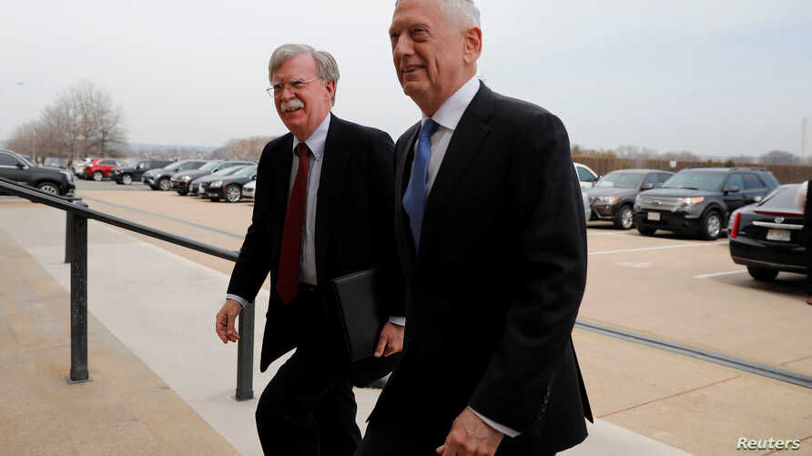 Secretary of Defense James Mattis greets Ambassador John Bolton (L), President Donald Trump's nominee to be National Security Advisor, as he arrives at the Pentagon in Washington, U.S., March 29, 2018.