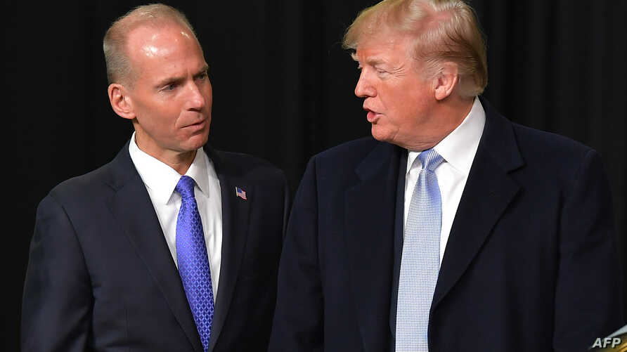 In this file photo taken on March 14, 2018, President Donald Trump speaks with Boeing CEO Dennis Muilenburg during a tour of the Boeing Company in St. Louis, Missouri.