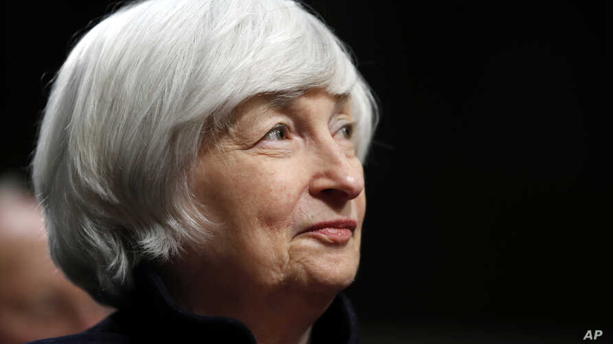 FILE - Federal Reserve Chair Janet Yellen listens to introductions as she is awarded the Paul H. Douglas Award for Ethics in Government, on Capitol Hill in Washington, Nov. 7, 2017.