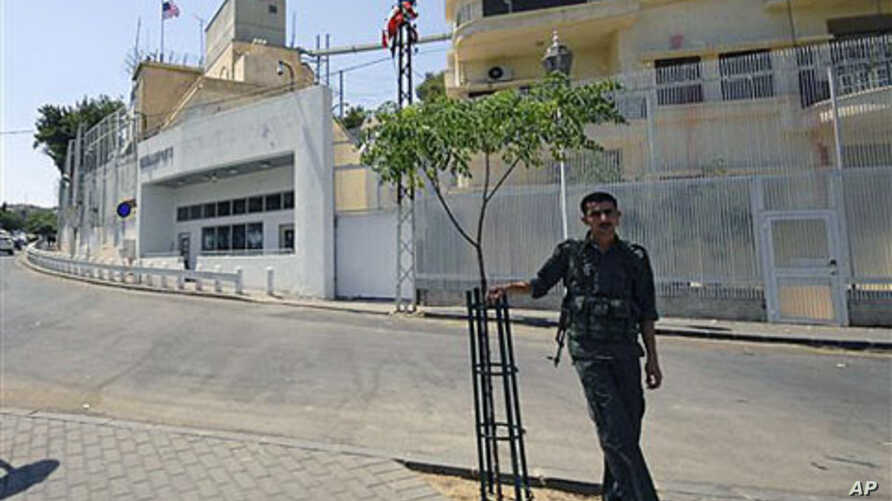 A Syrian security man stands guard in front of the U.S. embassy in Damascus, Syria, July 12 2011. (file photo)