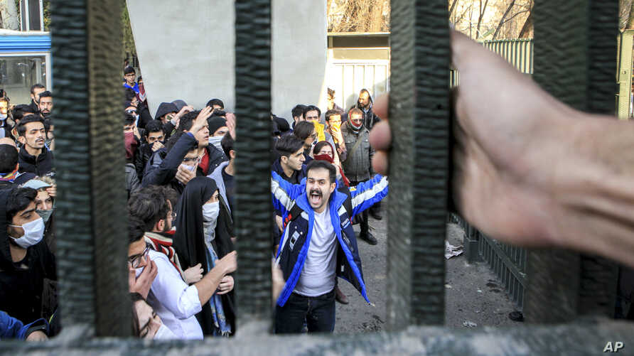 FILE - In this Dec. 30, 2017 file photo, taken by an individual not employed by the Associated Press and obtained by the AP outside Iran, university students attend an anti-government protest inside Tehran University, in Tehran, Iran.