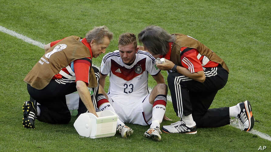 Germany's Christoph Kramer gets assistance during the World Cup final between Germany and Argentina at the Maracana Stadium in Rio de Janeiro, Brazil, July 13, 2014. Kramer was hit in the face by Argentina's Ezequiel Garay's shoulder.