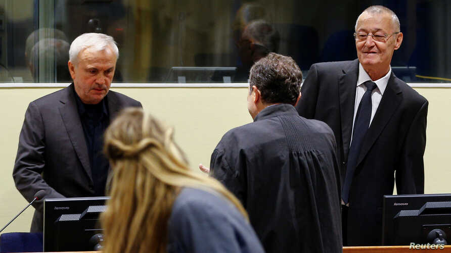 Jovica Stanisic and Franko Simatovic appear in court for their retrial at the United Nations Mechanism for International Criminal Tribunals in The Hague on June 13, 2017.