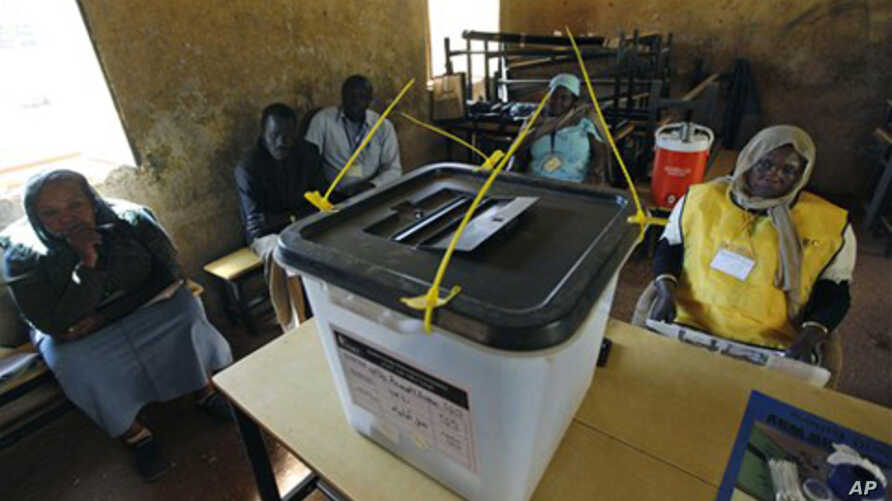 Polling staff and local observers at a polling center during the second day of the South Sudan referendum in the suburb of Khartoum, 10 Jan 2011