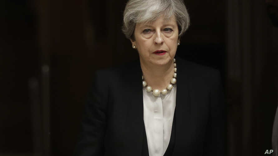 British Prime Minister Theresa May departs 10 Downing Street, London, to go to Manchester, May 23, 2017. The day after an apparent suicide bomber attacked an Ariana Grande concert as it ended Monday night, killing over a dozen of people among a panic